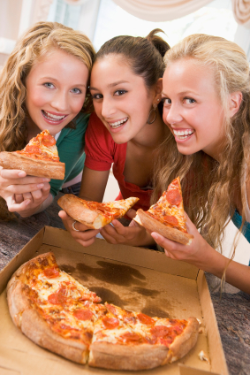 Teenage Girls Eating Pizza